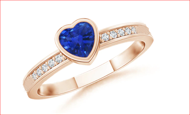 Ladies ring in 18k Rose Gold with side diamonds
